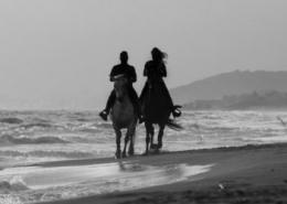 Couple-horseback-beach-resized-400×250-1-260×185